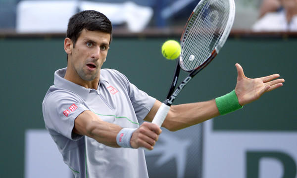 Novak Djokovic returns a shot during his third-round victory over Alejandro Gonzalez at the BNP Paribas Open at Indian Wells on Tuesday.