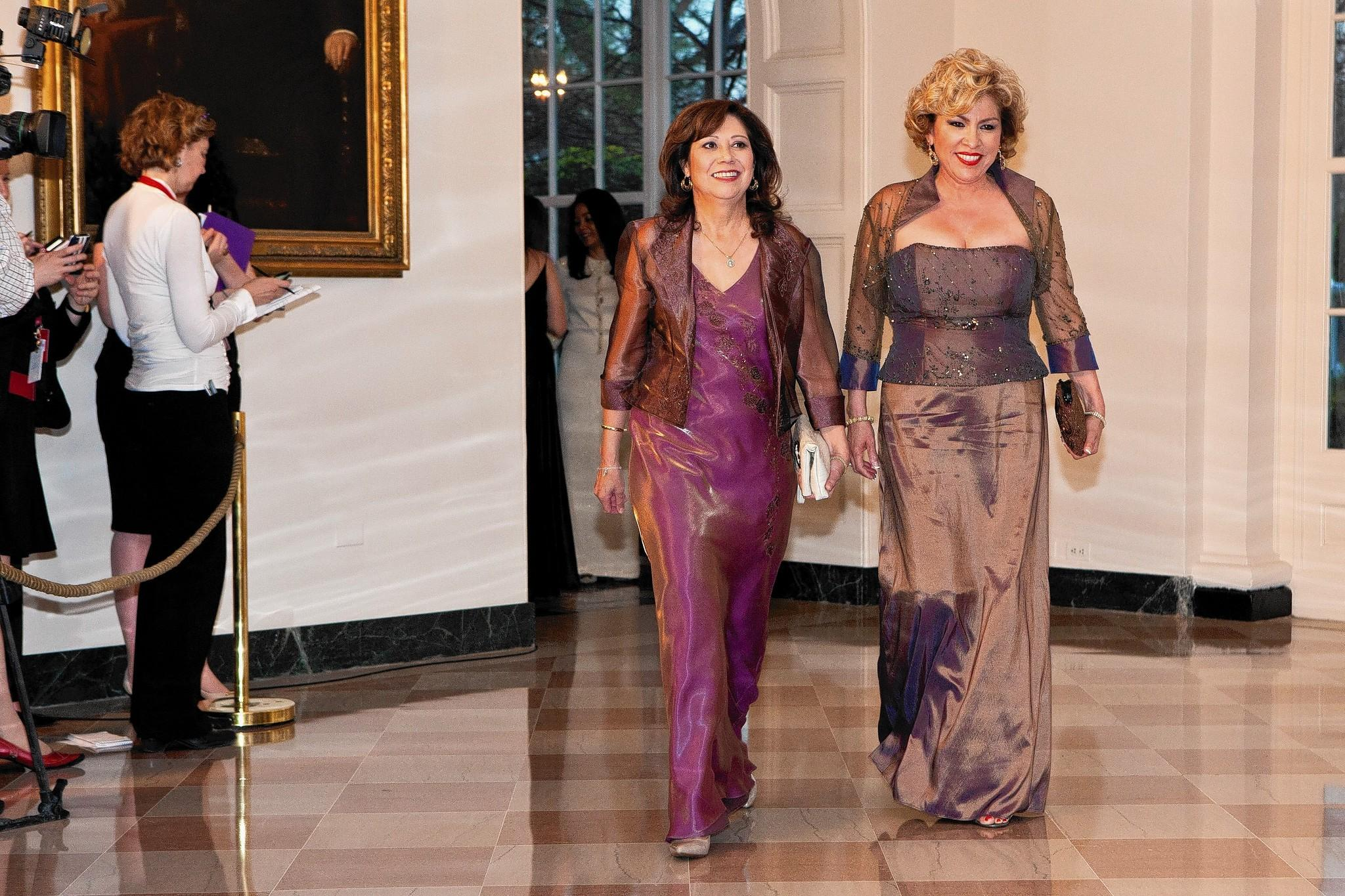 Then-Secretary of Labor Hilda Solis, left, and Rebecca Zapanta arrive for a state dinner in honor of British Prime Minister David Cameron at the White House on March 14, 2012.