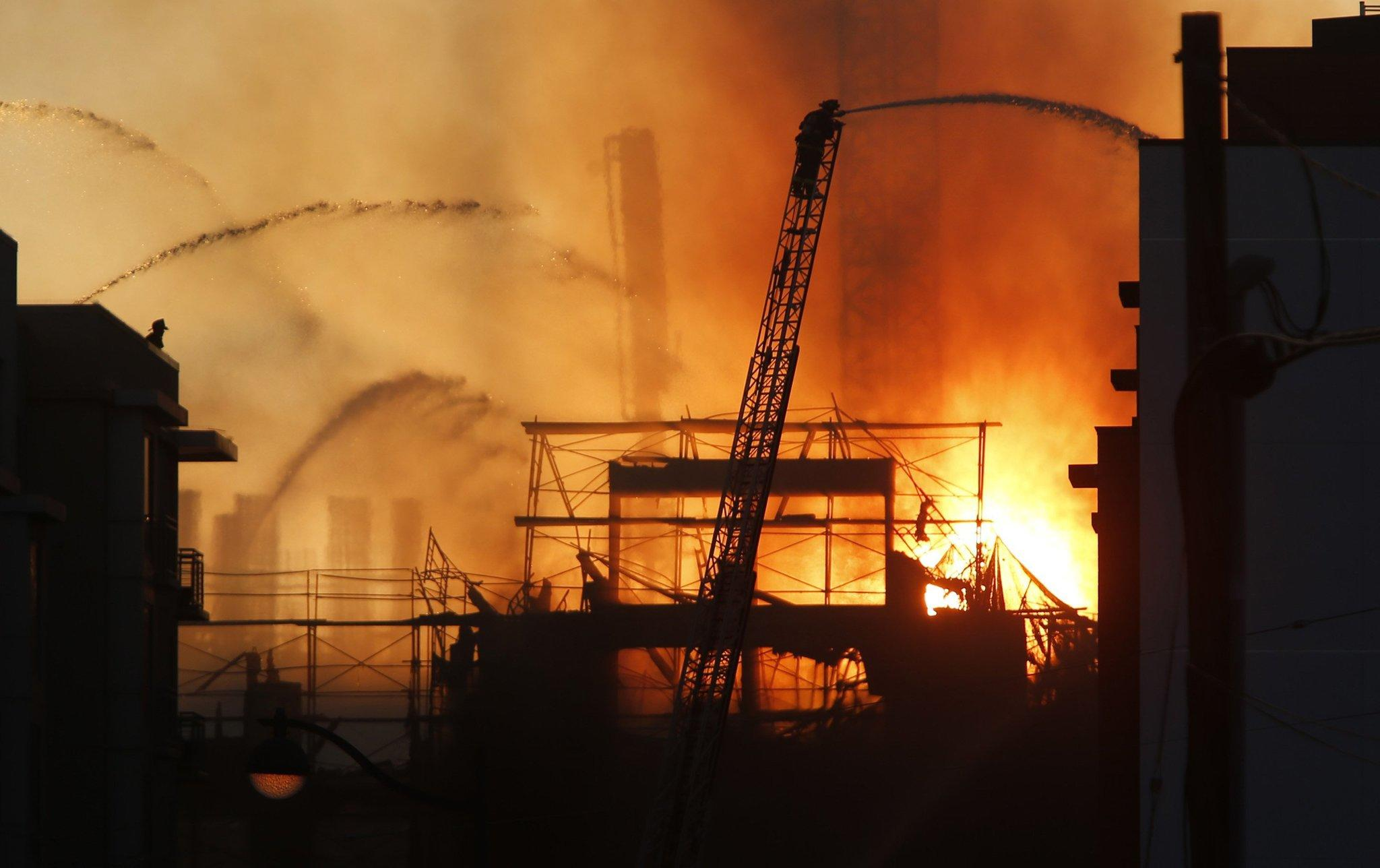 Firefighters battle a multi-story blaze in a residential building under construction in the Mission Bay neighborhood of San Francisco.