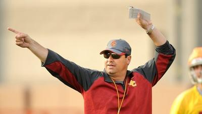 USC's Steve Sarkisian is on the go at first day of spring practice