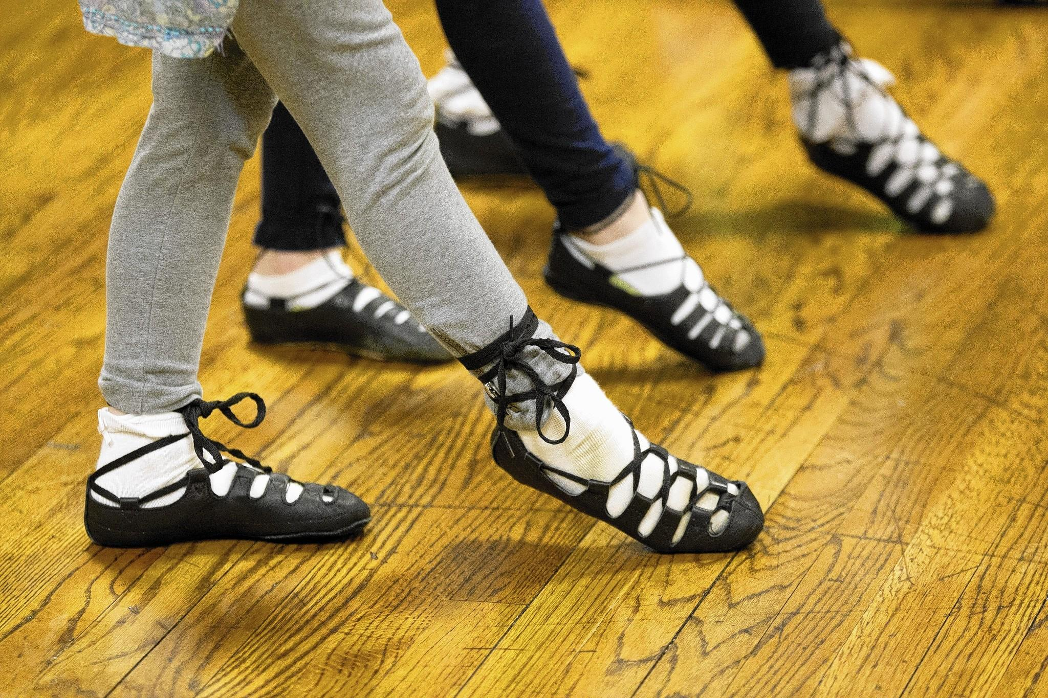 Melanie Mantler, left, 6, of Lutherville gets ready to dance during Irish dance class with The Egan School of Irish Dance at St. Pius X Catholic Church in Towson.