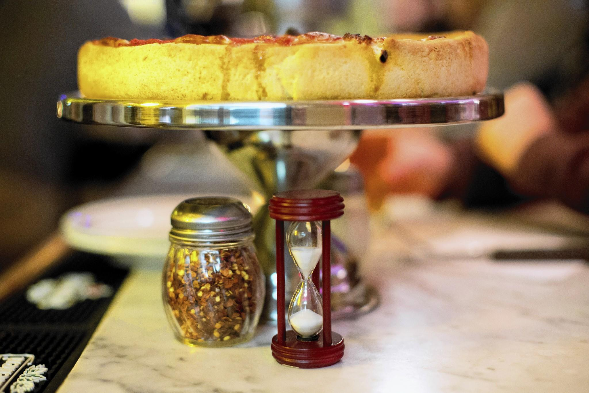 A three-minute timer is served with the pizzas at Emmett's, a pizza restaurant that specializes in Chicago-style deep dish pizza, in the SoHo neighborhood of New York.