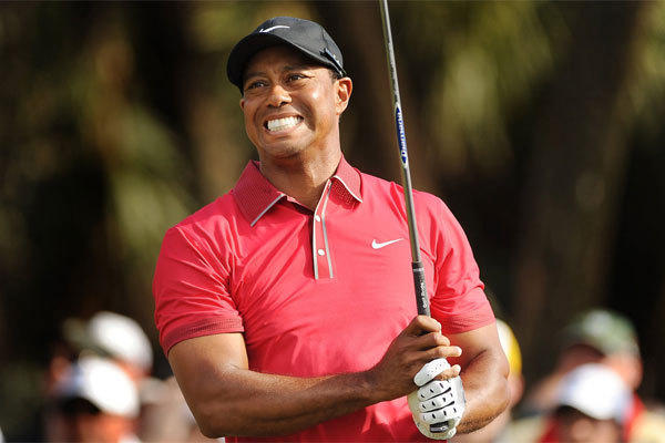 Tiger Woods grimaces as he follows through on his tee shot on the 12th hole during the final round of the WGC-Cadillac Championship at Trump National Doral on March 9.