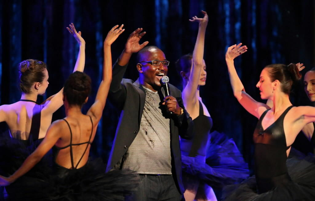 Hannibal Buress performs beside ballet dancers at the Vic Theatre during a taping for Comedy Central Jan. 25, 2014.