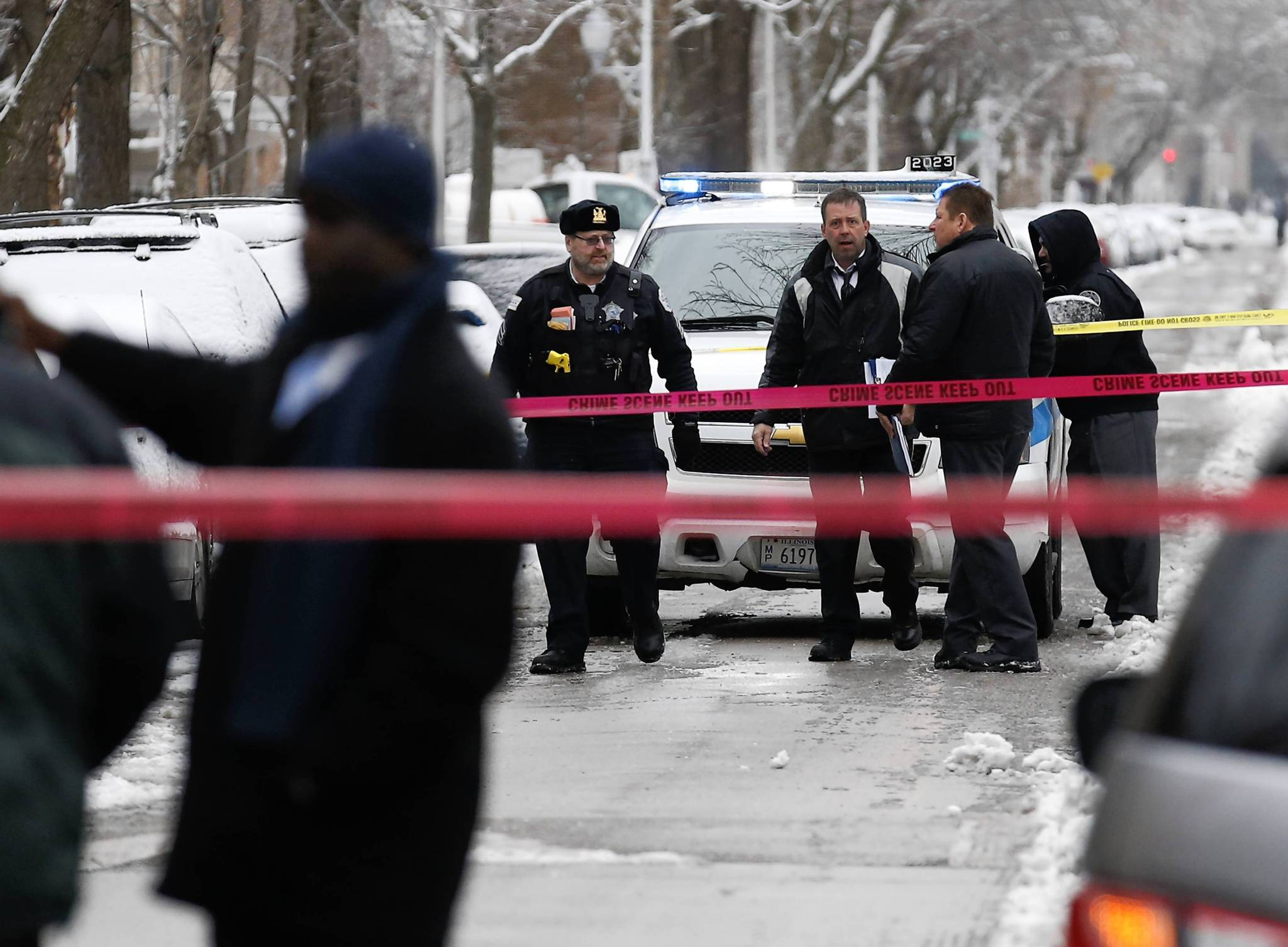 Chicago police investigate near the scene where a 23-year-old man was shot this morning on the 5800 block of North Kenmore Avenue in the Edgewater Beach neighborhood in Chicago.