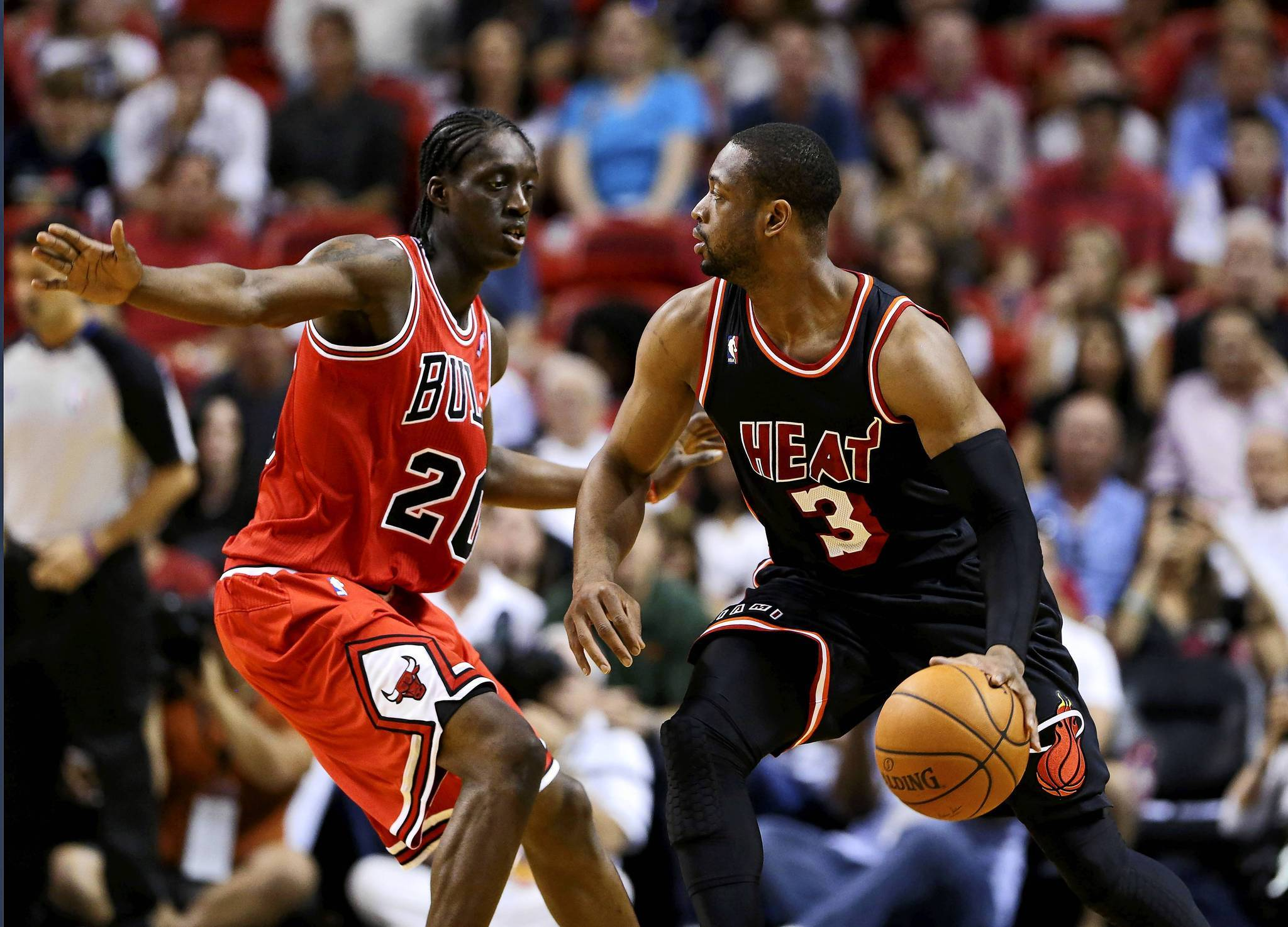 The Bulls Tony Snell (left) guards Dwyane Wade of the Heat during a game in February.