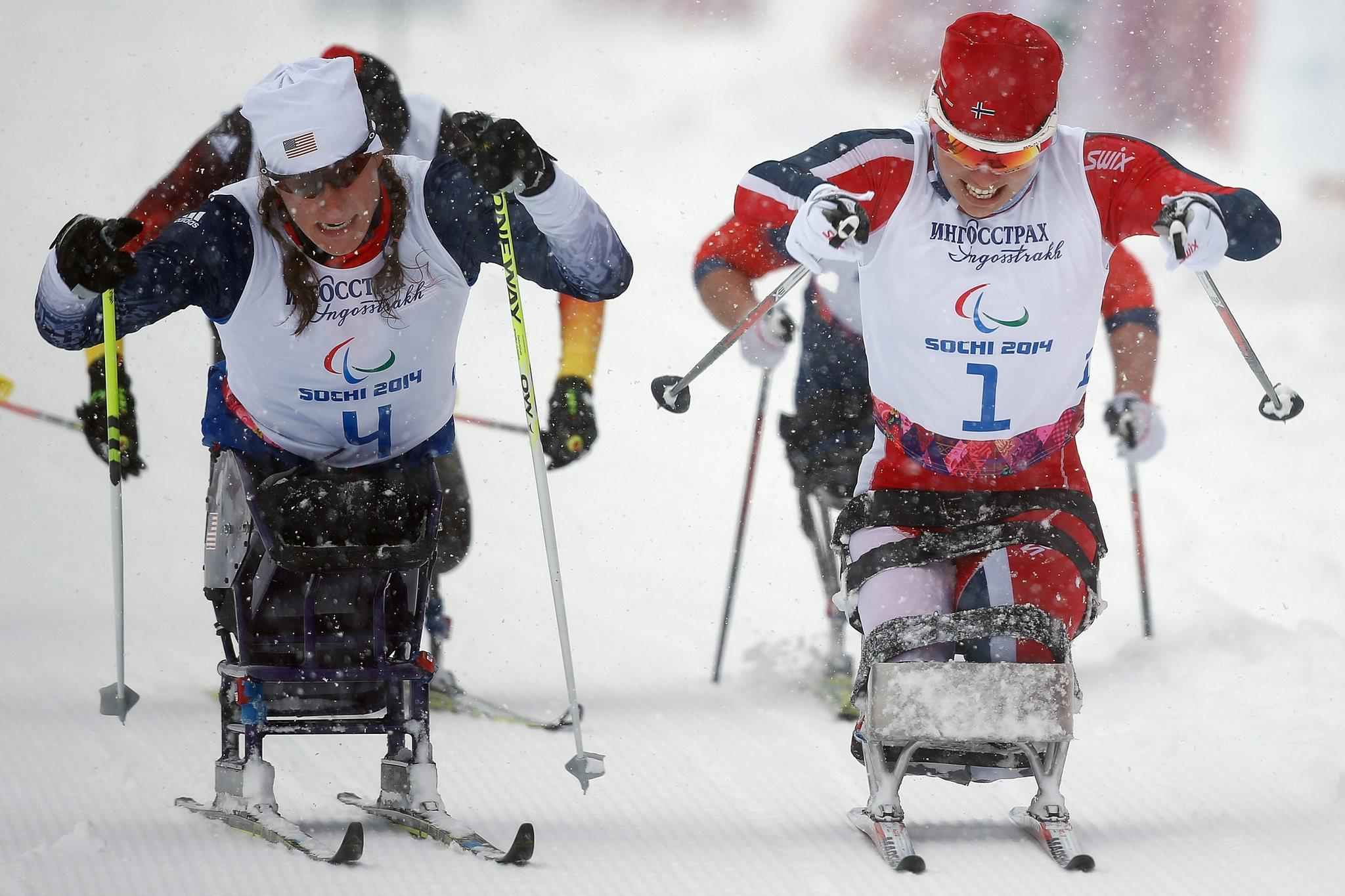 Tatiana McFadden (left) battles at finish of Wednesday's Paralympic cross-country sprint with Mariann Marthinsen of Norway. McFadden won the silver medal, .1 second behind Marthinsen.
