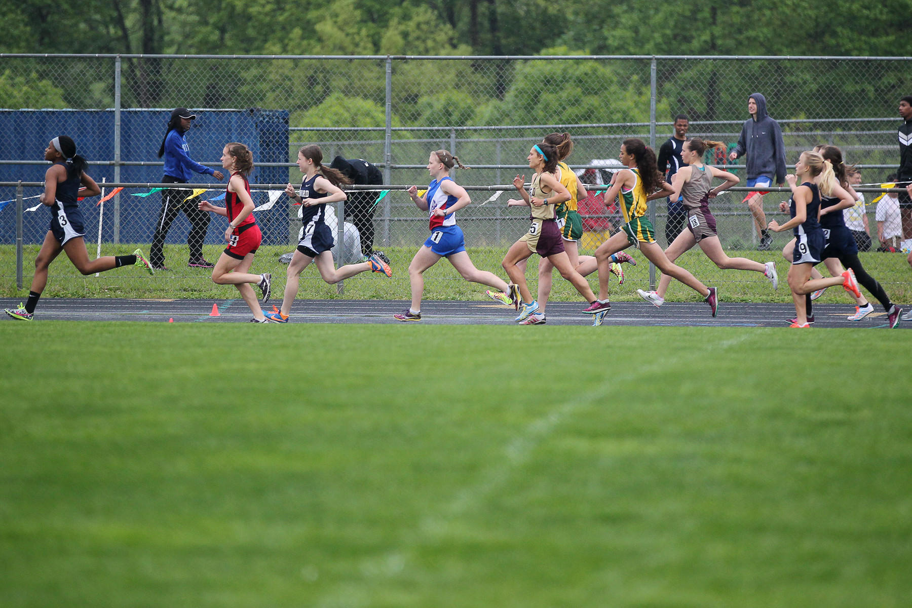 Girls race in the first 1600 Meter Run during the 2013 Howard County outdoor track and field championship.