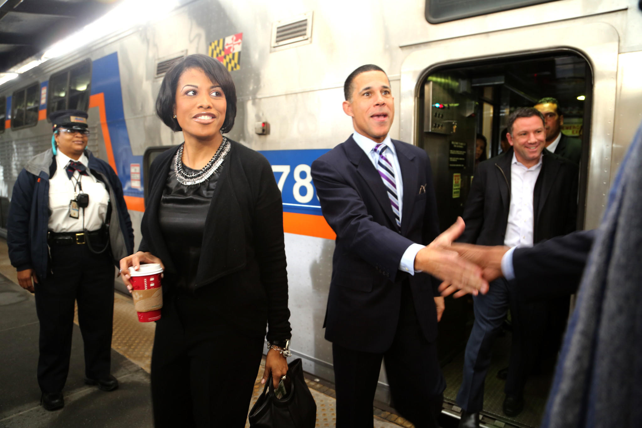 Mayor Stephanie Rawlings-Blake and Lt. Gov. Anthony Brown step off the MARC train after riding the very first train into Baltimore from Union Station in Washington, D.C. The new weekend service for the MARC began this Saturday.