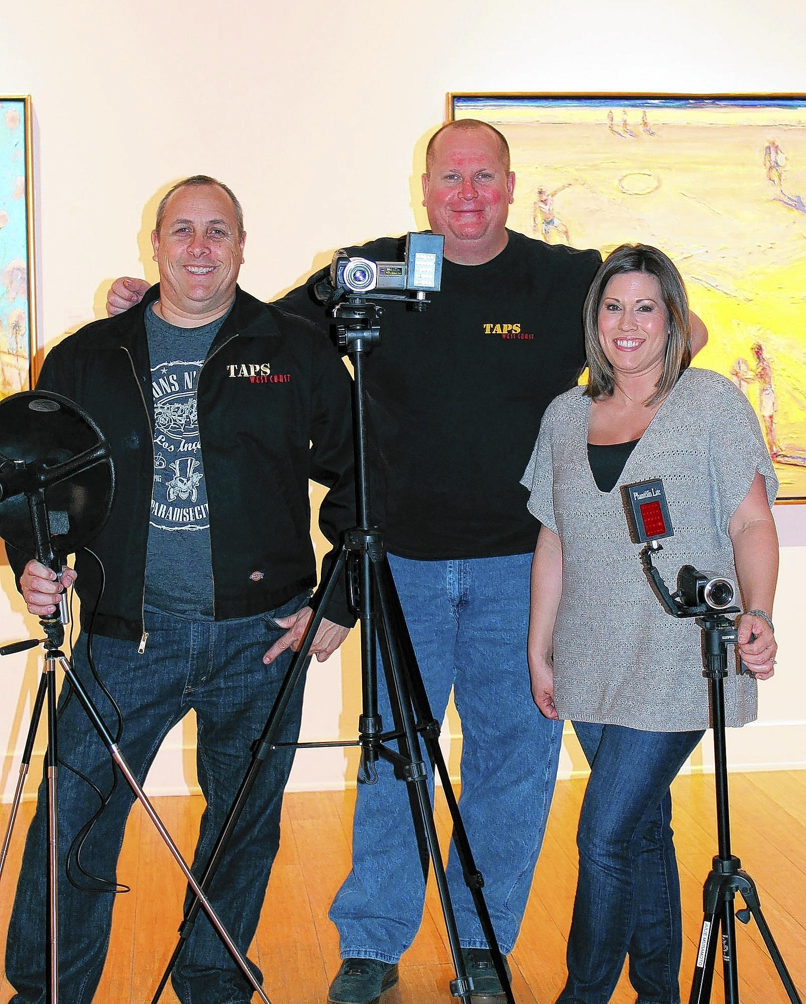 From left, Christopher Turner, Chad Weber and Julie Muramoto, members of The Atlantic Paranormal Society (TAPS) West Coast, pose for a portrait at the Laguna Art Museum on Saturday.
