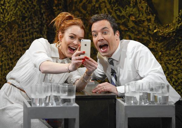 "Lindsay Lohan snaps a selfie with Jimmy Fallon during her visit to  ""The Tonight Show."""