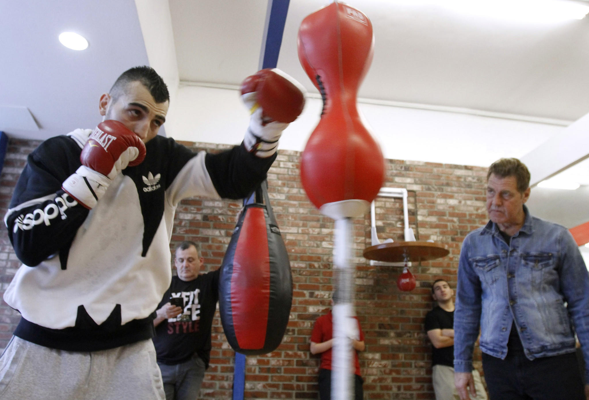 With trainer Joe Goosen keeping a close watch at right, boxer Vanes Martirosyan trains at Ten Goose Boxing gym in Van Nuys on Tuesday, March 11, 2014 as he prepares for an upcoming fight.
