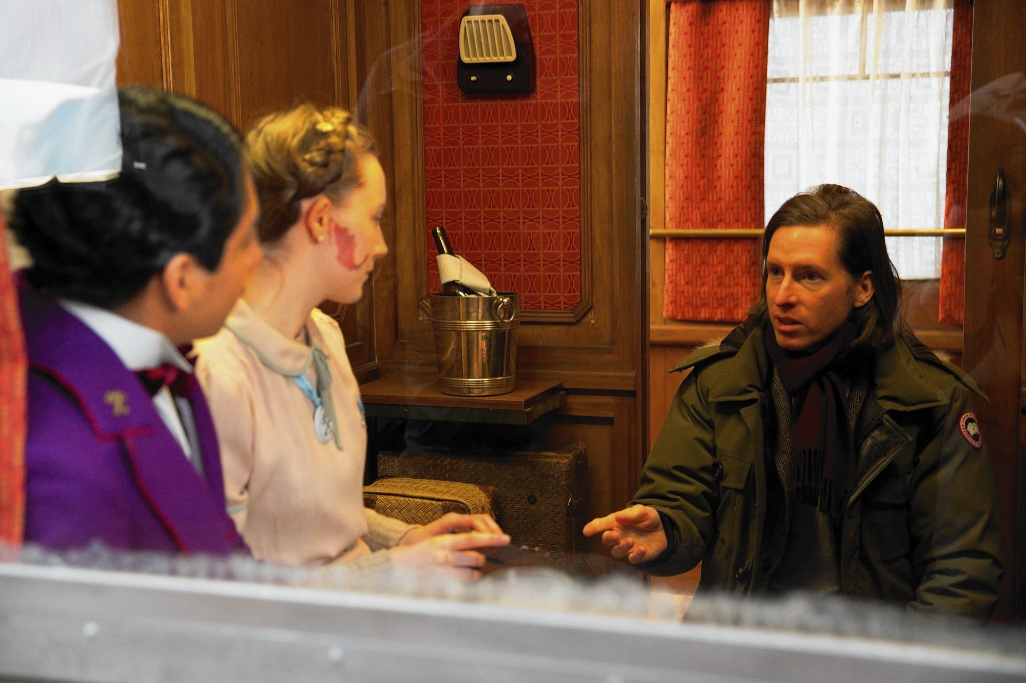 "Tony Revolori, Saoirse Ronan and Wes Anderson are seen on the set of ""The Grand Budapest Hotel."""