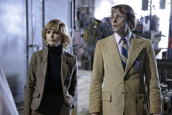 "KGB spies Elizabeth Jennings (Keri Russell) and Philip Jennings (Matthew Rhys) don disguises to steal military secrets from a shipyard on ""The Americans."""