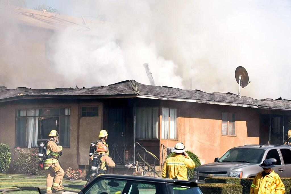 Firefighters were battling a blaze that engulfed a triplex in Burbank on Wednesday, March 12, 2014, in the 700 block of East Palm Avenue, just south of Glenoaks Boulevard.