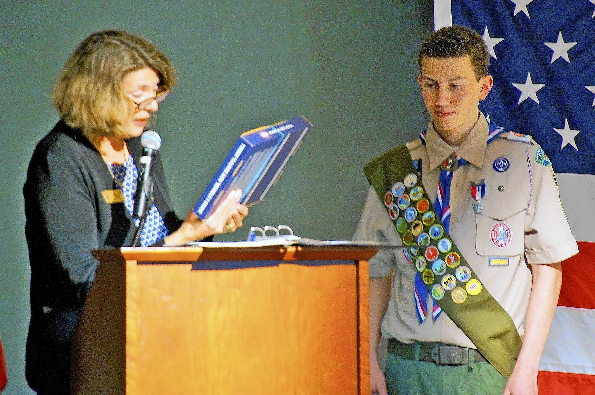 Theresa Lamb Simpson, representing Rep. Adam Schiff, presents a letter of commendation to new Eagle Scout Sam Weinberger at a Court of Honor held March 2.