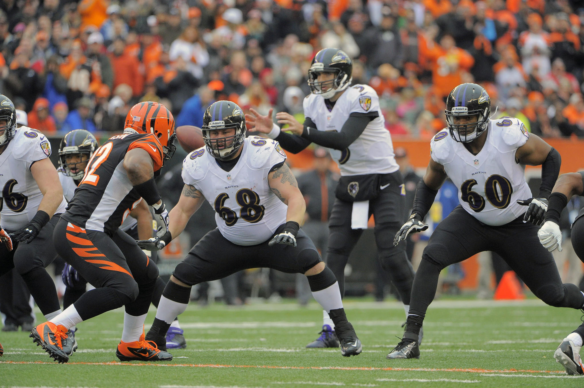 Ravens center A.Q. Shipley and offensive tackle Eugene Monroe line up as Joe Flacco takes a snap in the final game of the regular season in December.