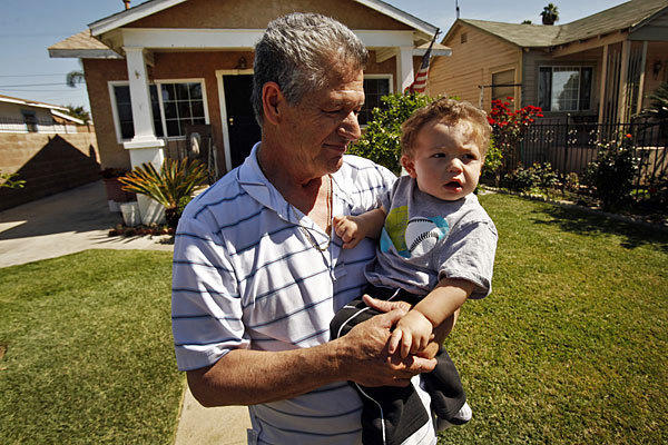 Jose Luis Jimenez, holding his grandson Jason Jimenez, is a resident of the neighborhood where elevated levels of lead were found.