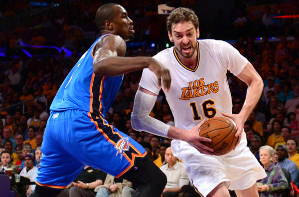 Lakers power forward Pau Gasol (16) drives to the basket against Thunder power forward Serge Ibaka during a 114-110 victory on Sunday at Staples Center.