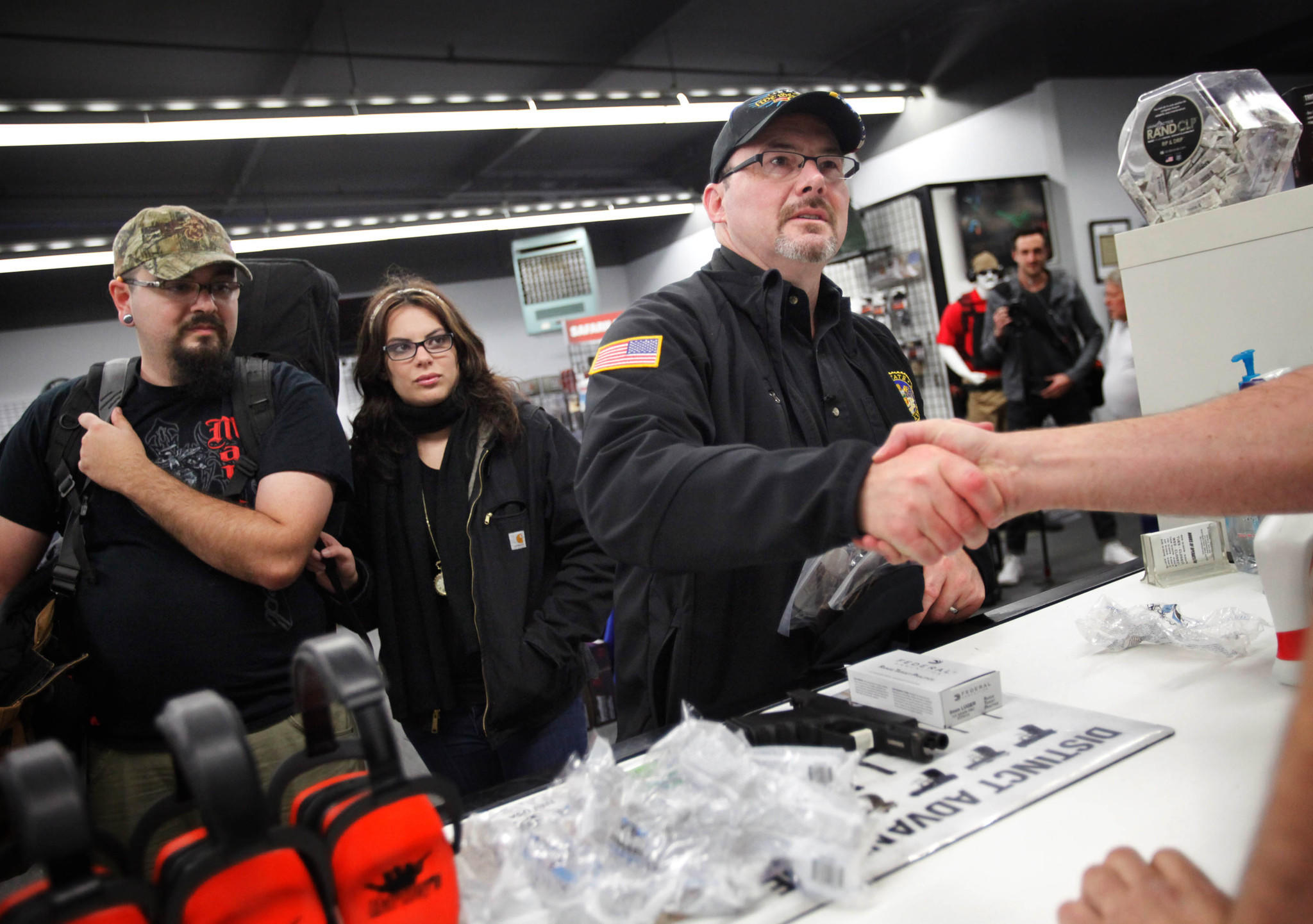 Assemblyman Tim Donnelly, a Republican candidate for governor, is losing his campaign manager, Jennifer Kerns, shortly before his party's convention. Donnelly, an outspoken gun rights advocate, is pictured here shaking hands at a Santa Cruz County gun range in February.