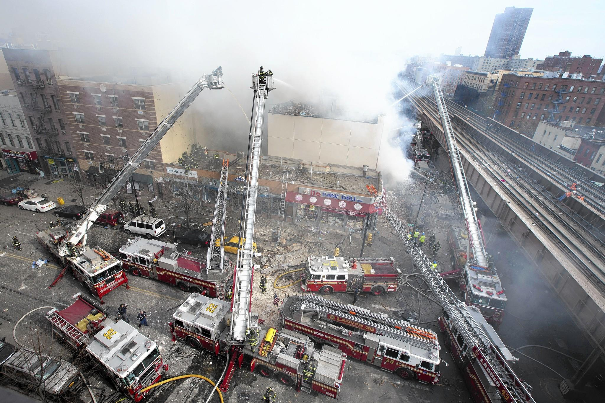 Firefighters battle a blaze in a collapsed building in East Harlem. A resident of one of the two destroyed buildings said neighbors had reported an overpowering smell of gas to fire officials a day earlier.