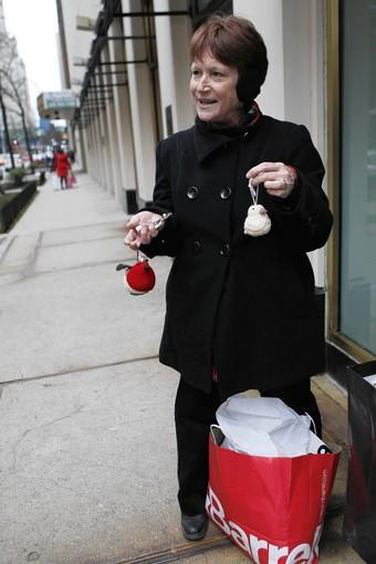 """<i>54, homemaker, Kalamazoo, Mich.</i><br> <br> A gold medalist in the category of Plan Ahead Christmas Shopping, Nelson displays Crate & Barrel bird ornaments to adorn <i>next year's</i> Christmas packages. As for this year's shopping, major Christmas gifts for the kids — college student Ellen, 20, and grad student  Jim, 22 — will be electronics. On her own wish list? Husband Don, below, is """"a great jewelry buyer."""""""