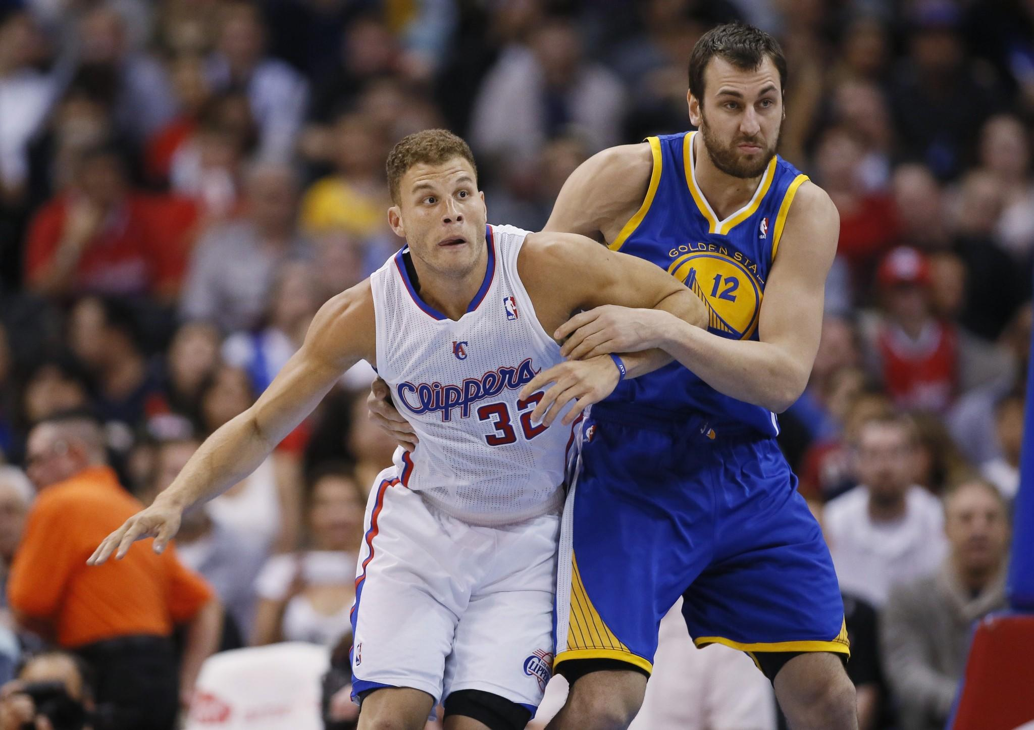 Clippers power forward Blake Griffin, left, battles for position with Golden State Warriors center Andrew Bogut during the first half of Wednesday's game at Staples Center.