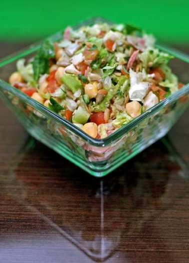 The Chop Stop Classic salad has grilled chicken, salami, chickpeas, cucumbers, tomatoes and sunflower seeds with basalmic vinaigrette dressing.