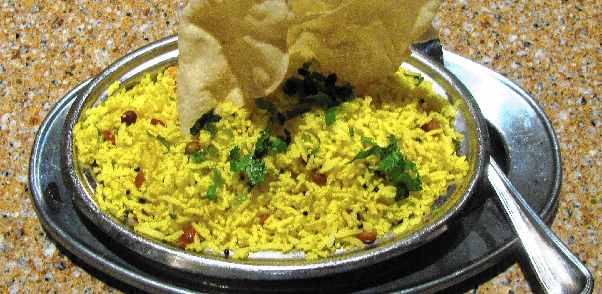 The lemon saddam rice is buttery and lemony, with a contrasting texture of toasted cashews and fried lentils.
