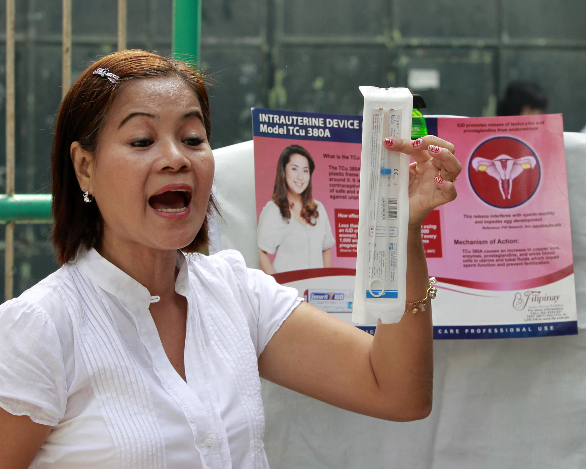 A medical worker explains a family planning method using the Intra Uterine device (IUD) to housewives in a local government health centre in Navotas, Metro Manila March 3, 2011.