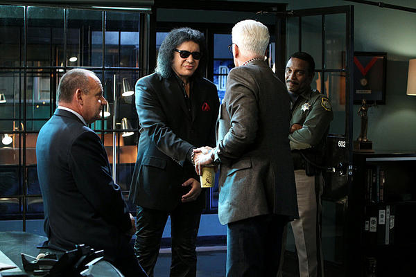 "Guest star Gene Simmons of KISS, second from left, guest stars on the hit ""CSI: Crime Scene Investigation,"" with Paul Guilfoyle, Ted Danson, and Larry Mitchell. It's among the slew of shows that CBS is renewing."