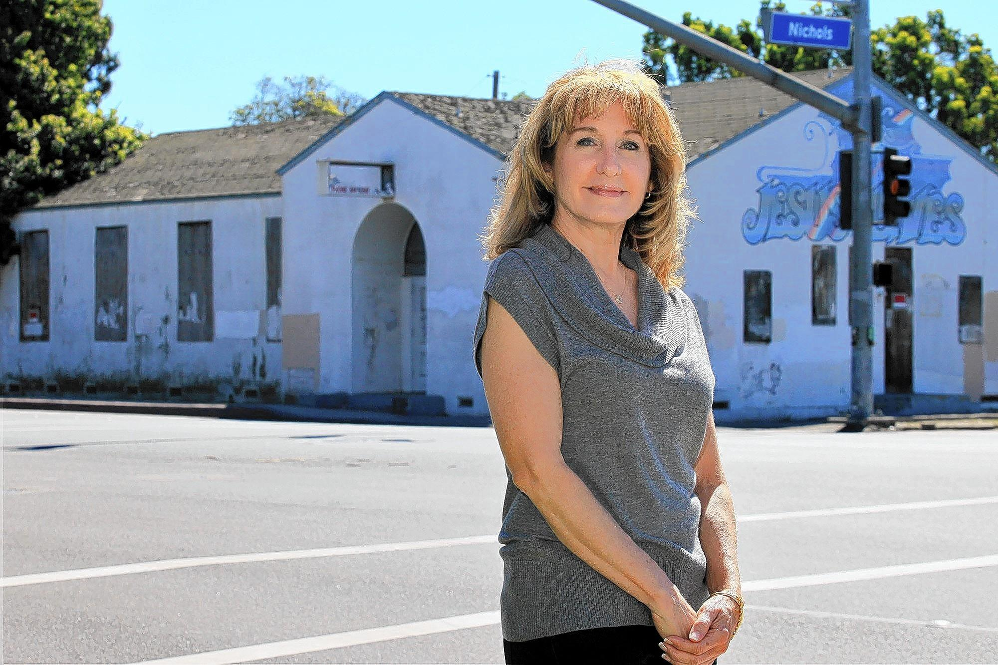 Mary F. Adams Urashima poses for a photo in front of the former Wintersburg Japanese Presbyterian Church, dedicated in 1934, in Huntington Beach.