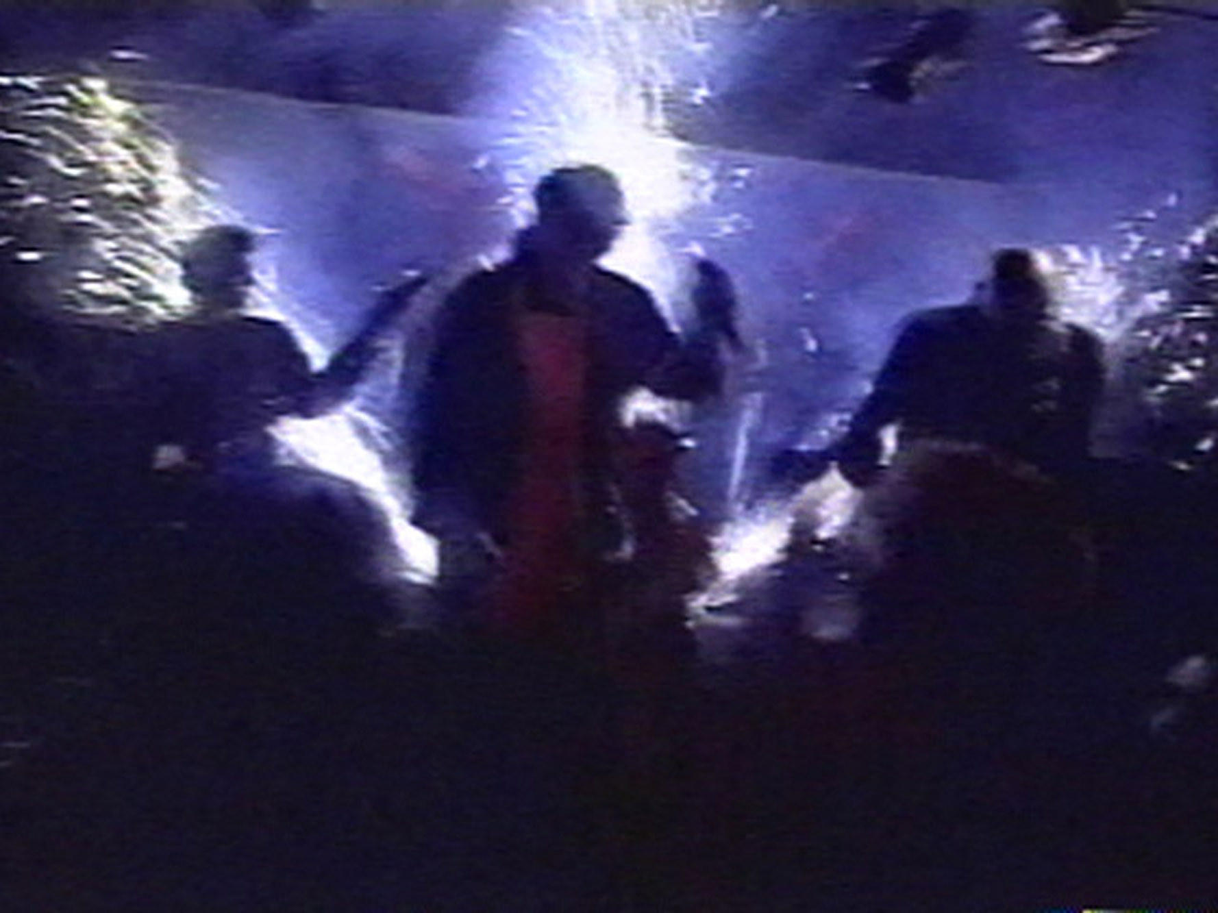 Great White lead singer Jack Russell and the band perform, in this view from television, moments before the group's pyrotechnic display set off a deadly fire at the Station nightclub in West Warwick, R.I., on Feb. 20, 2003.