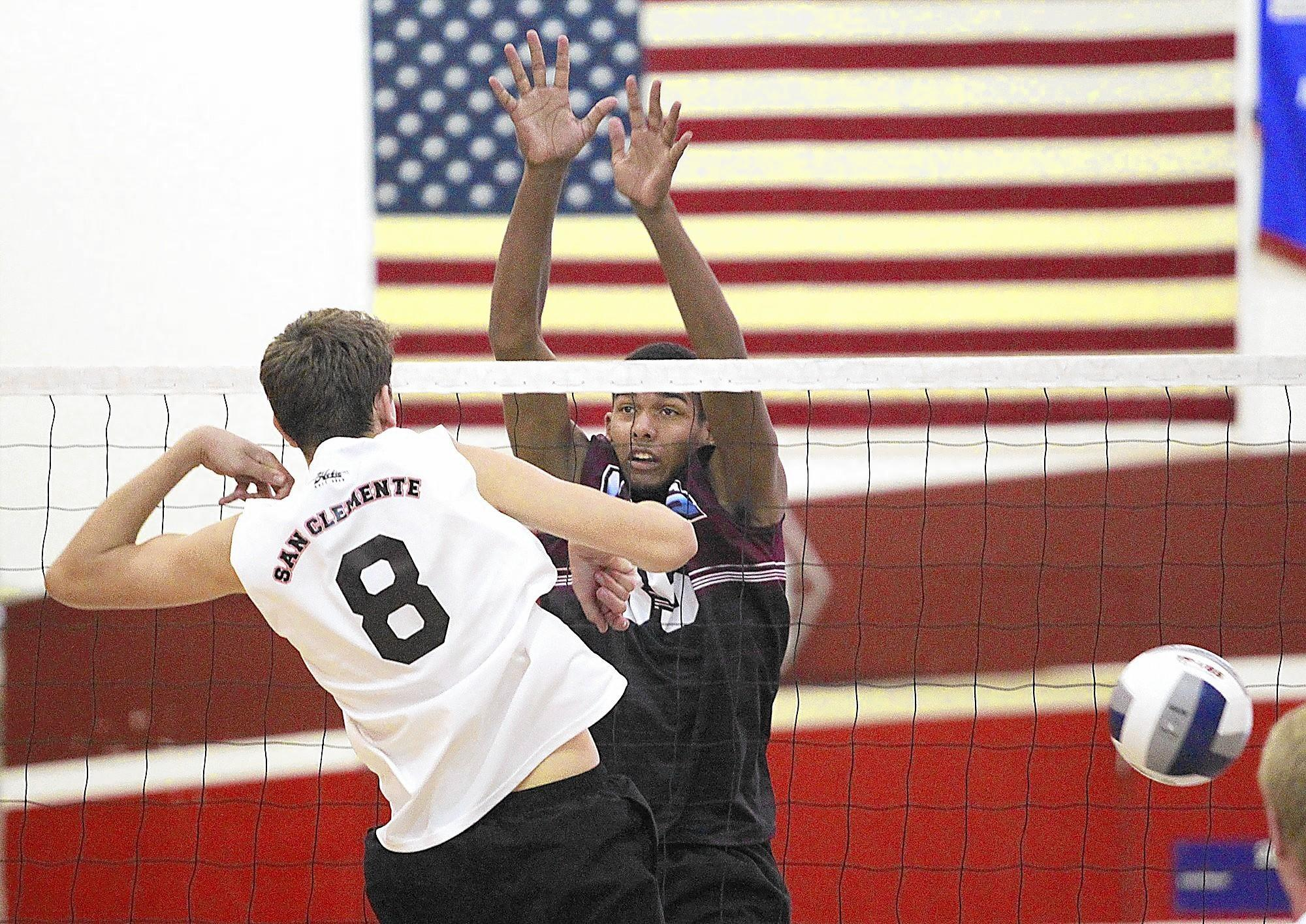 Laguna Beach High's Noah Blanton blocks a shot point blank against San Clemente on Tuesday at Laguna Beach High.