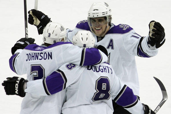 Drew Doughty (8) is congratulated by Jack Johnson (3) and Anze Kopitar after scoring the game-winning goal against the New Jersey Devils on Jan. 31, 2010, part of a franchise-record nine-game winning streak.