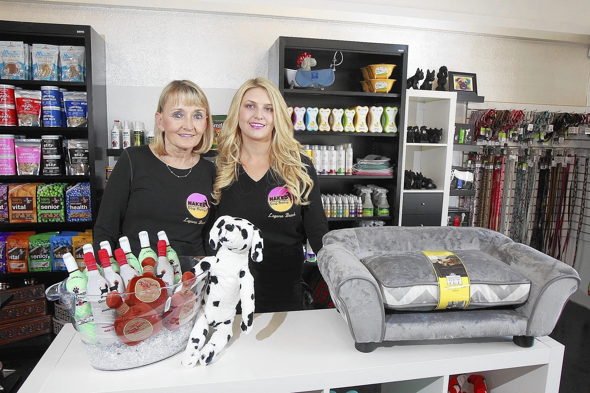 Charlotte Bloom, left, and daughter Lindsay Poe opened the Naked Dog Bistro that specializes in healthy dog treats, toys and treatments.