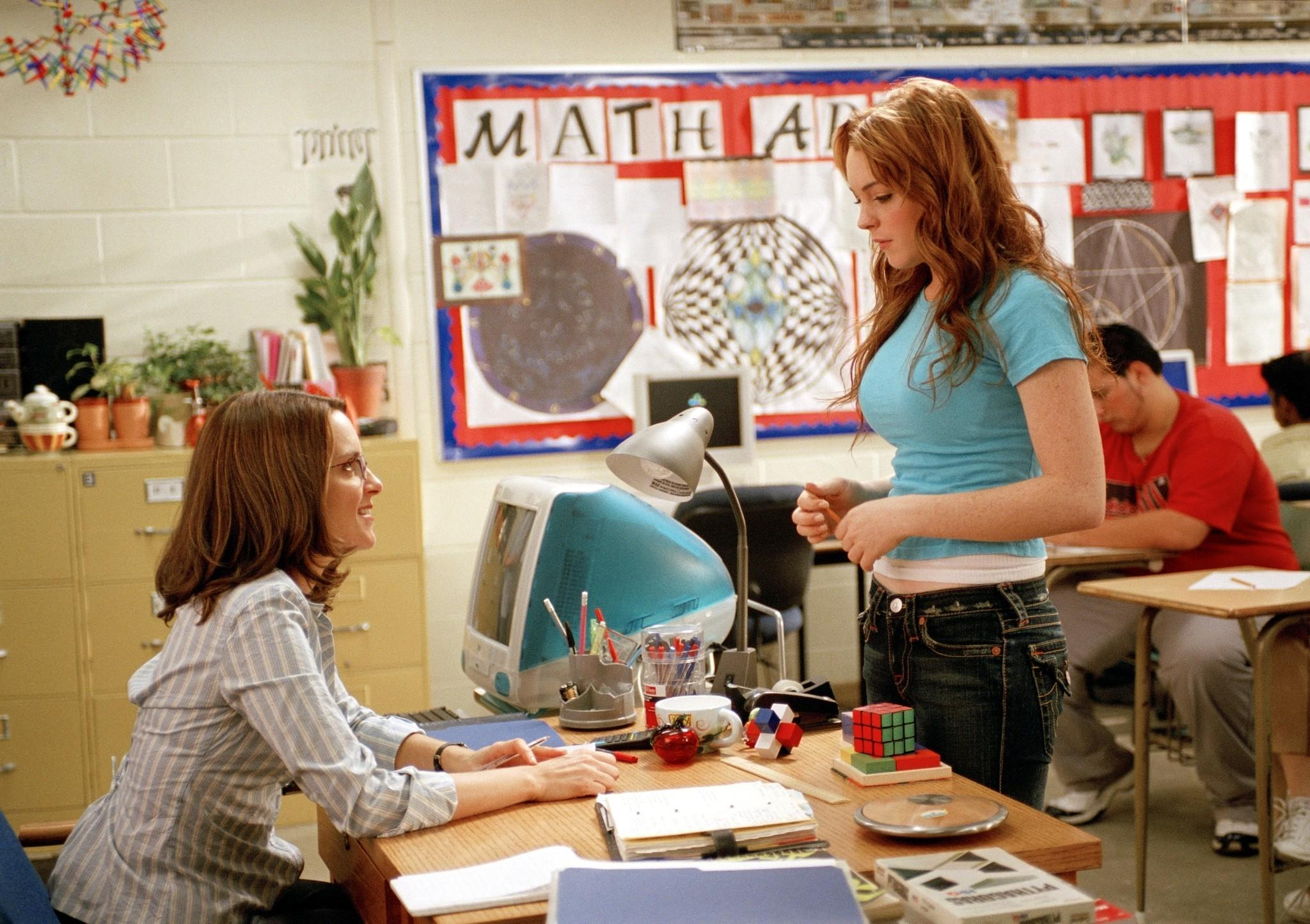 "Tina Fey as Ms. Norbury and Lindsay Lohan as Cady in the 2004 comedy ""Mean Girls."" Fey said that a reunion film is unlikely but the cast and crew may still plan some sort of get-together to commemorate the film's 10-year anniversary."