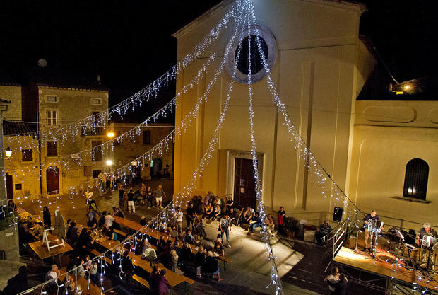 Dinner and fun in the piazza of Civitella del Lago during the festa (festival) that is held there each summer.