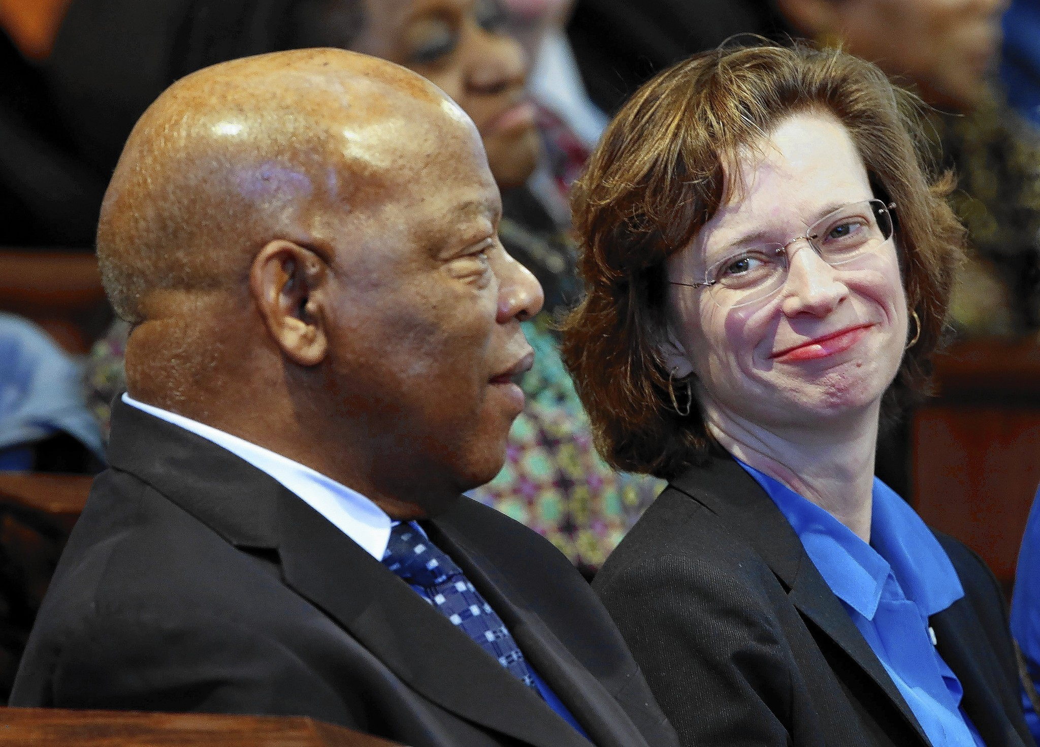 Moderate Democrat Michelle Nunn, shown with Rep. John Lewis (D-Ga.), is running aganst several Republicans for a Senate seat from Georgia.