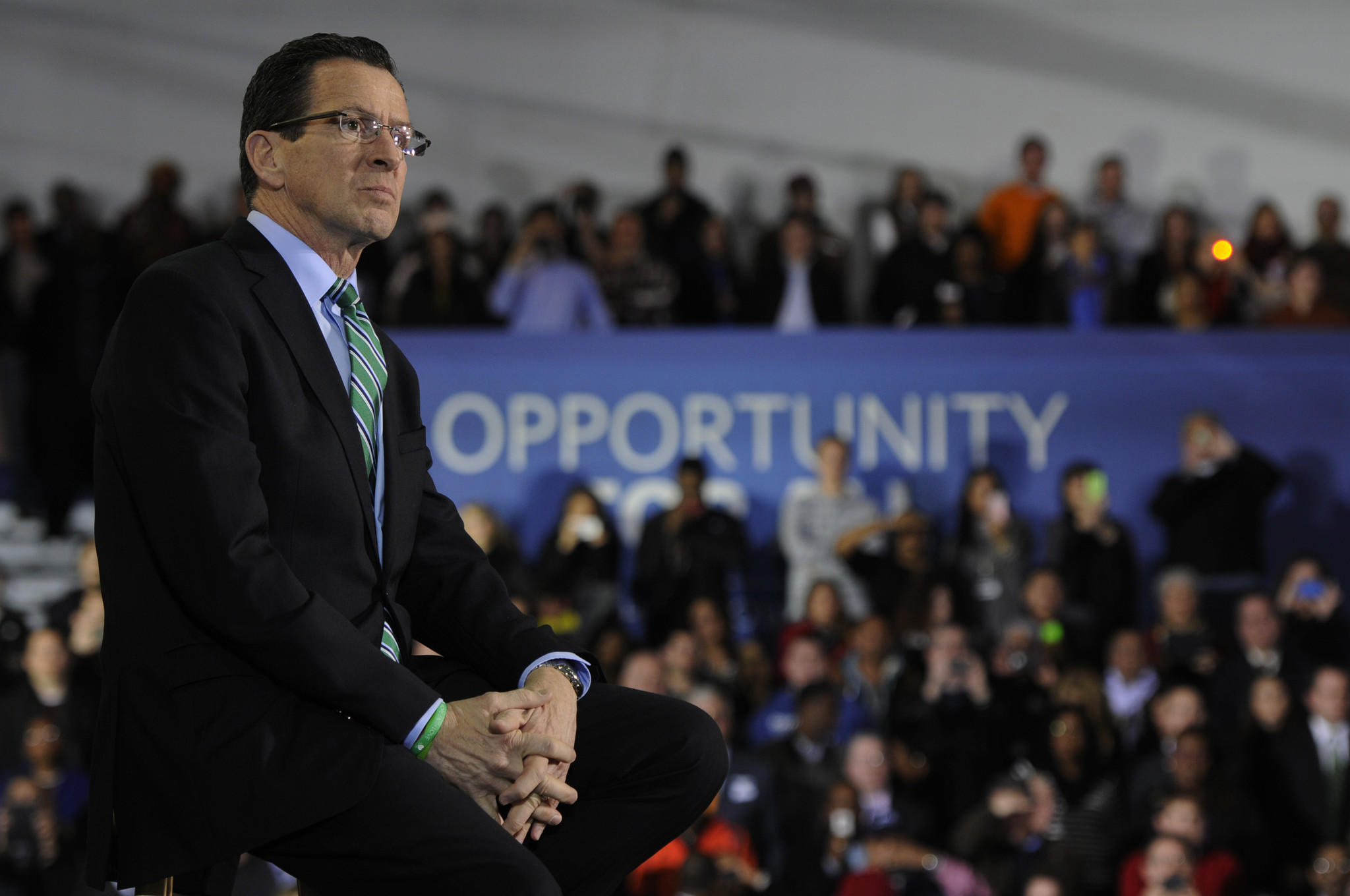 Gov. Dannel P. Malloy listens to President Obama's speech on raising the minimum wage as the president visited the state on March 5.