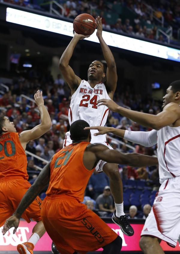 N.C. State Wolfpack's T.J. Warren (24) puts up a shot during the first half of Atlantic Coast Conference Tournament against the Miami Hurricanes at the Greensboro Coliseum in Greensboro, N.C., on Thursday, March 13, 2014.