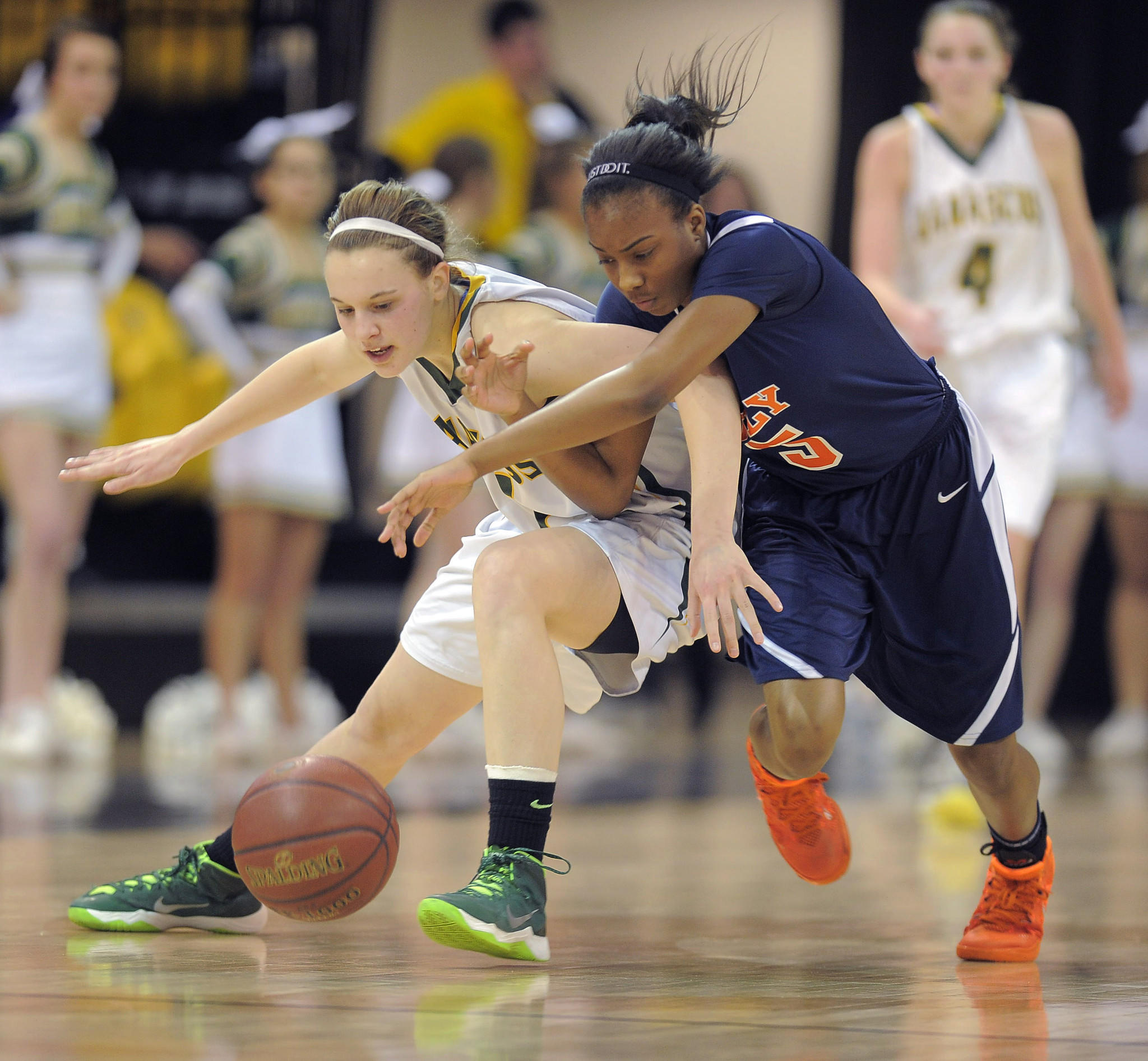 Damascus' Jenna Kauffman (1) and Poly's Khepera Stokes (5) chase after a loose ball.