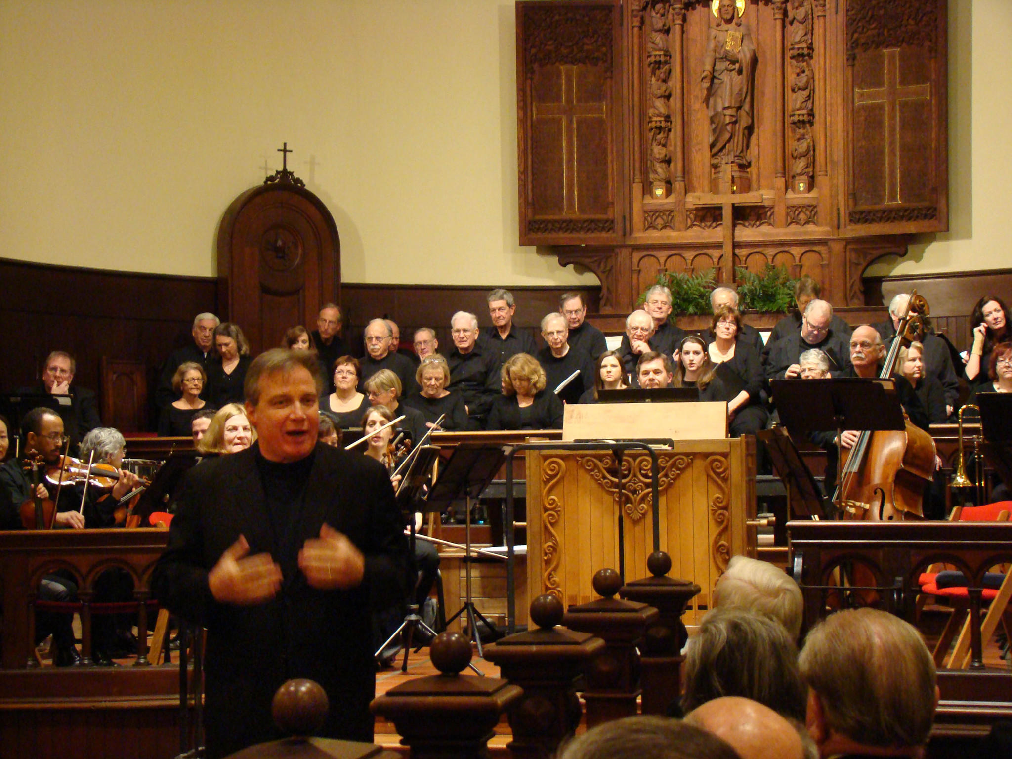 "Director and conductor J. Ernest Green talks with the audience prior to the recent Live Arts Maryland concert at St. Anne's Episcopal Church in Annapolis. The concert brought together the Annapolis Chorale Chamber Chorus, Annapolis Chamber Orchestra and soloists. The next concert at St. Annes concert will be ""The Spirit Soars: Music of the Russian and Eastern Traditions,""April 4 and 5. Photo by Bud Johnson for the Baltimore Sun"