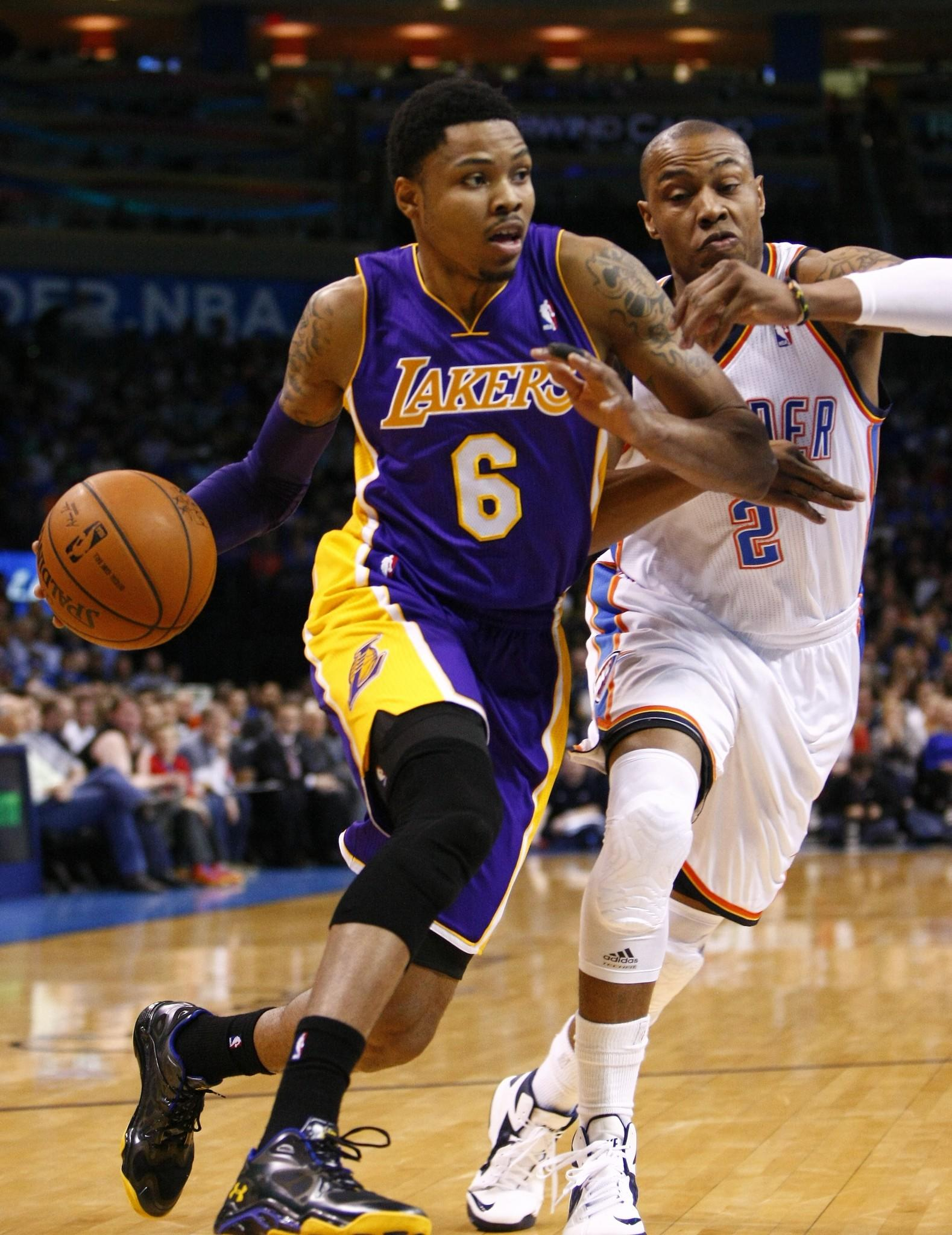 Kent Bazemore is defended by Oklahoma's Caron Butler during the first half of the Lakers' game against the Thunder at Chesapeake Energy Arena.