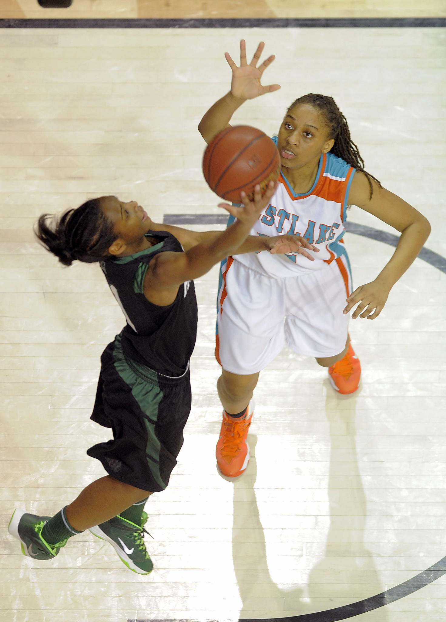 Milford Mill's Dionna White shoots a hook for two points after stripping Westlake's Nialla Curtis of the rebound.