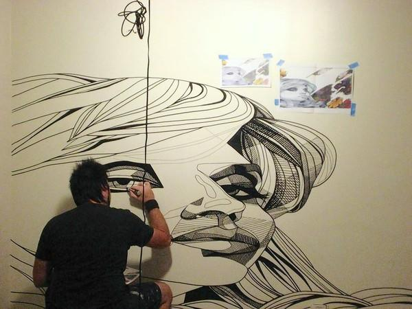 "Orlando artist Andrew Spear works on a mural for MTV's ""Real World Las Vegas."" Credit: Courtesy Andrew Spear"