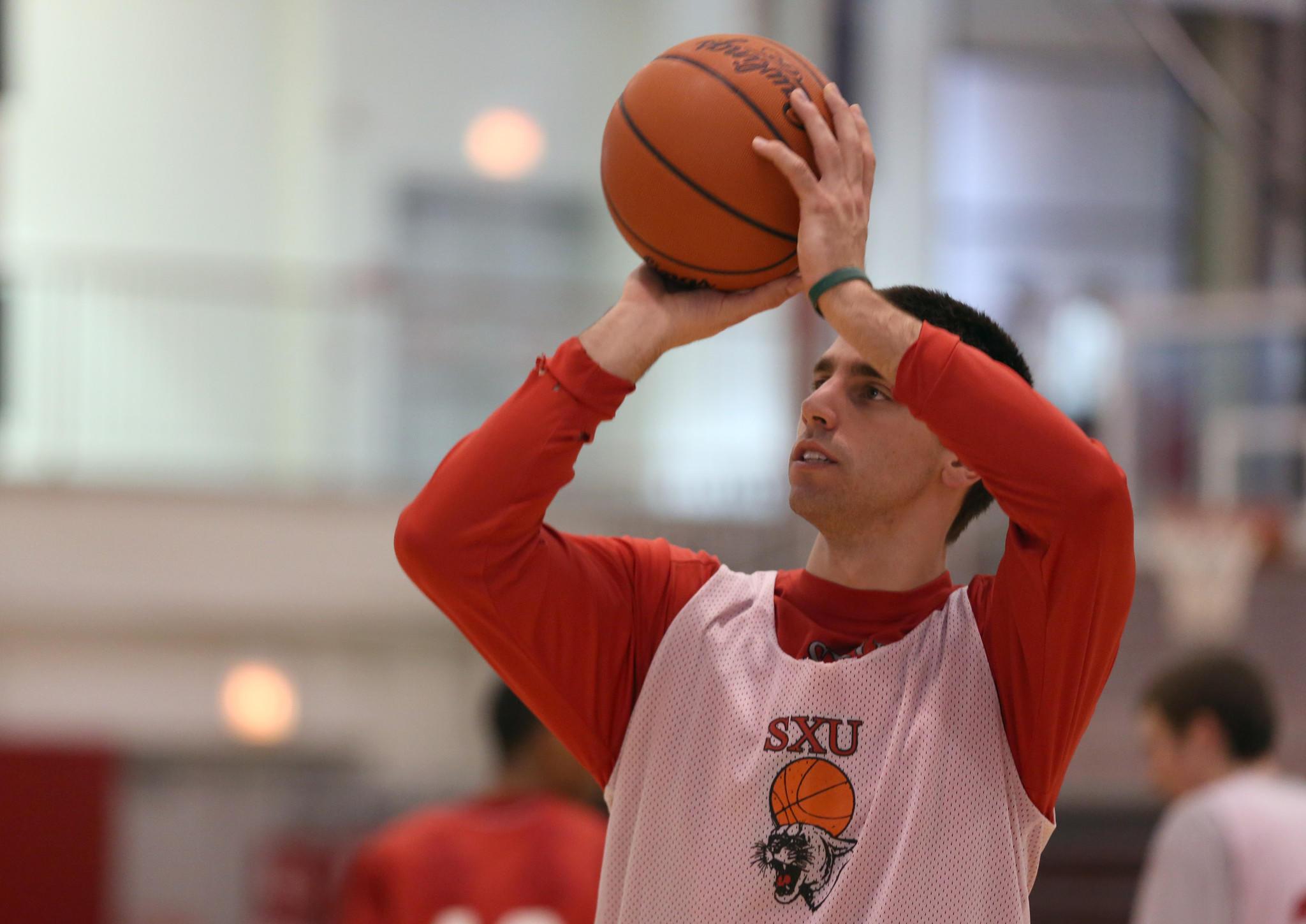 Saint Xavier's Brad Karp finished his career No. 4 on the state's collegiate career scoring list.