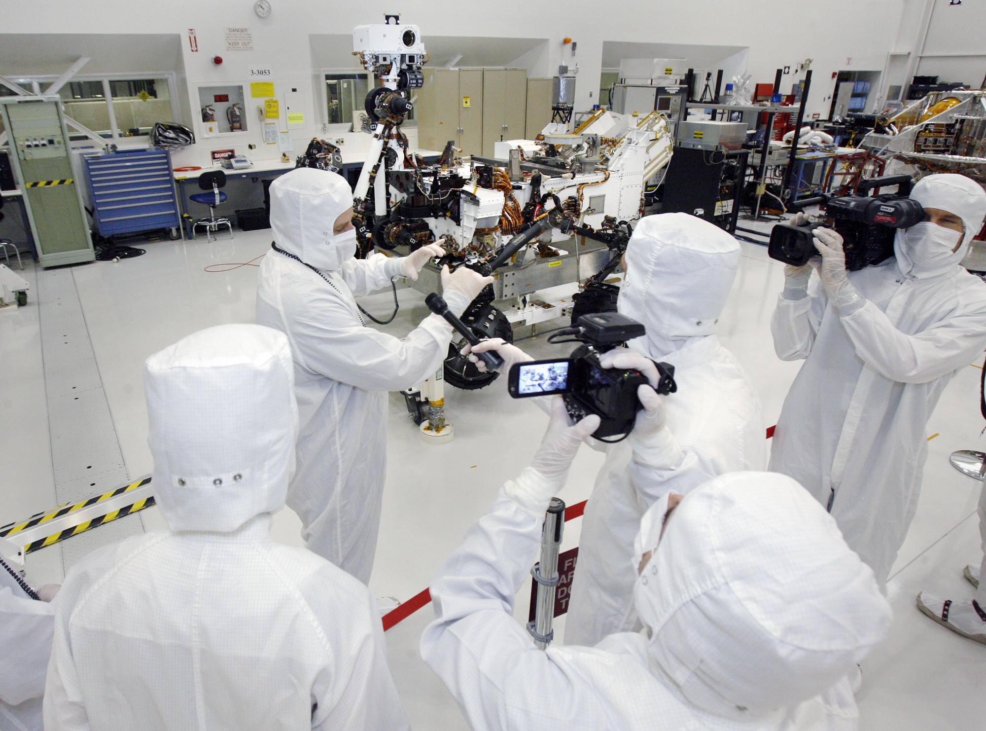 News media, including Bill Nye, the Science Guy, interview Peter Illsley, the rover integration lead, in the clean room at Jet Propulsion Laboratory on Monday, April 4, 2011, in La Cañada Flintridge where scientists assembled the Mars rover Curiosity.