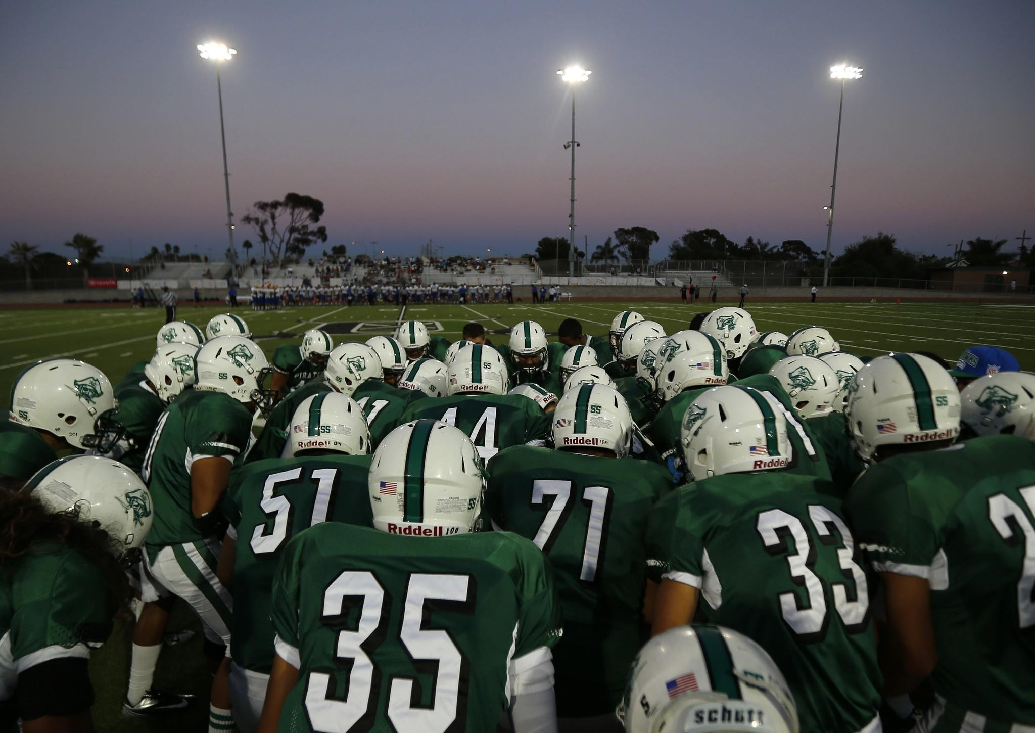 Oceanside Pirates gather before their Friday night high school football game against Mira Mesa in Oceanside, California September 14, 2012.