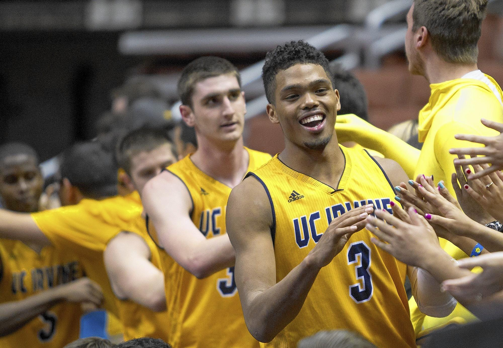 UC Irvine's Will Davis and teammates are congratulated by fans after beating UC Riverside 63-43 to open the Big West Tournament on Thursday.